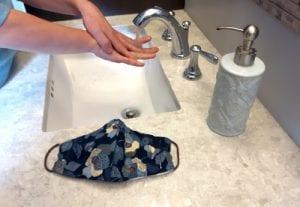 washing hands in sink