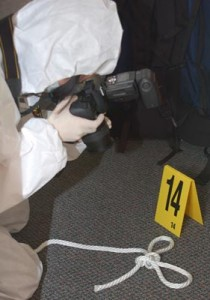 Student photographing evidence during the CSI Academy