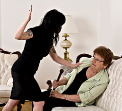 Younger woman hitting older woman with cane
