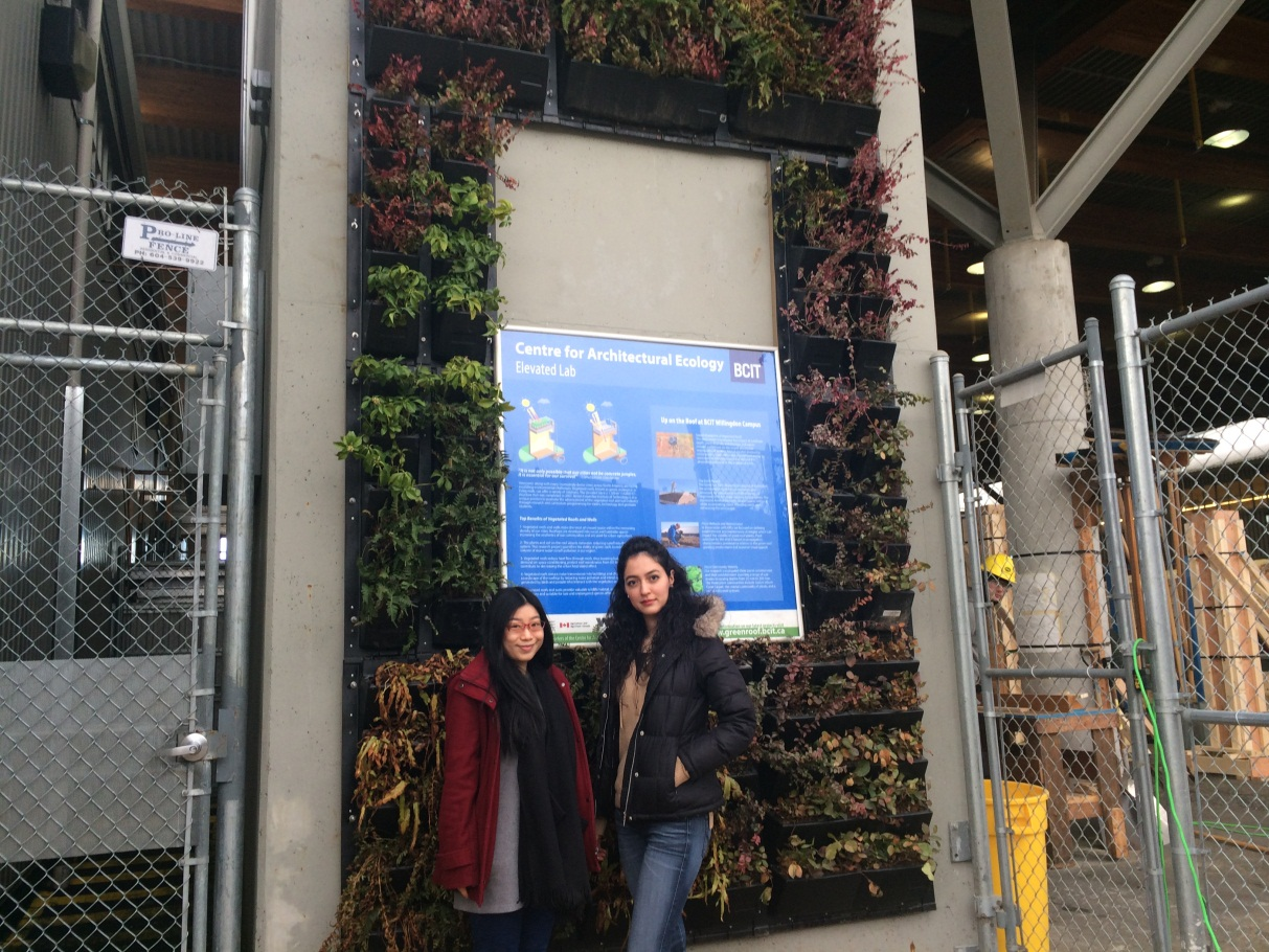 From left to right – Rosa Lin and Mahsa Akbarnejad, Masters of Applied Science in Building Science students at BCIT stand in front of the Burnaby Campus's new Elevated Lab Living Wall.