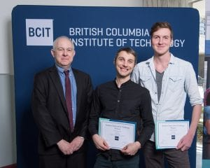 """Kim Dotto (left), Dean, Applied Research presenting winner for Applied Research to Andrew Miltimore (right), Aaron Redina (middle) for their entry """"ElastoKers – Design and Development of a Kinetic Energy Recovery System""""."""