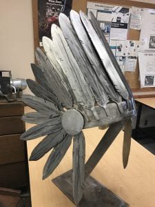 A metal headdress made by Metal Fabricator student Niki Jenkins sits in the BCIT classroom