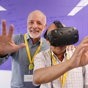Computer Systems Technology faculty Bill Klug and Medhat Elmasry try out the Vive virtual technology at the BCIT Tech Hub launch.