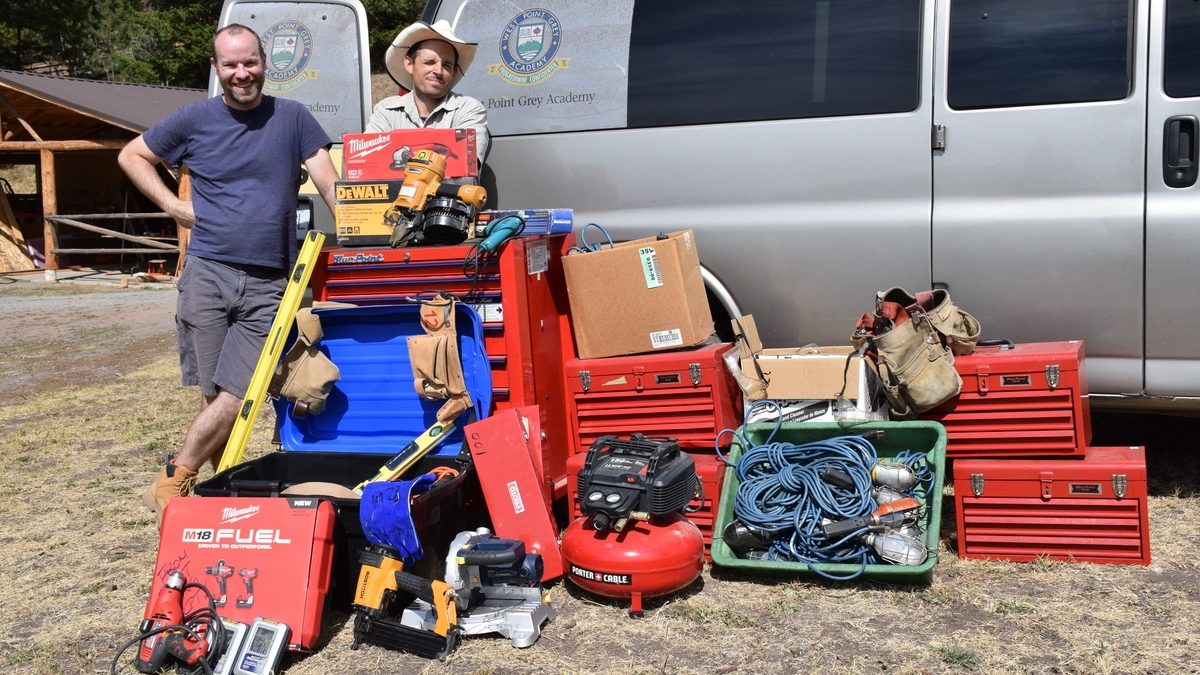 Jesse Darnell [left] and his cousin Patrick Spencer pose with the tools and equipment they drove to the Ashcroft Indian Band Reserve.