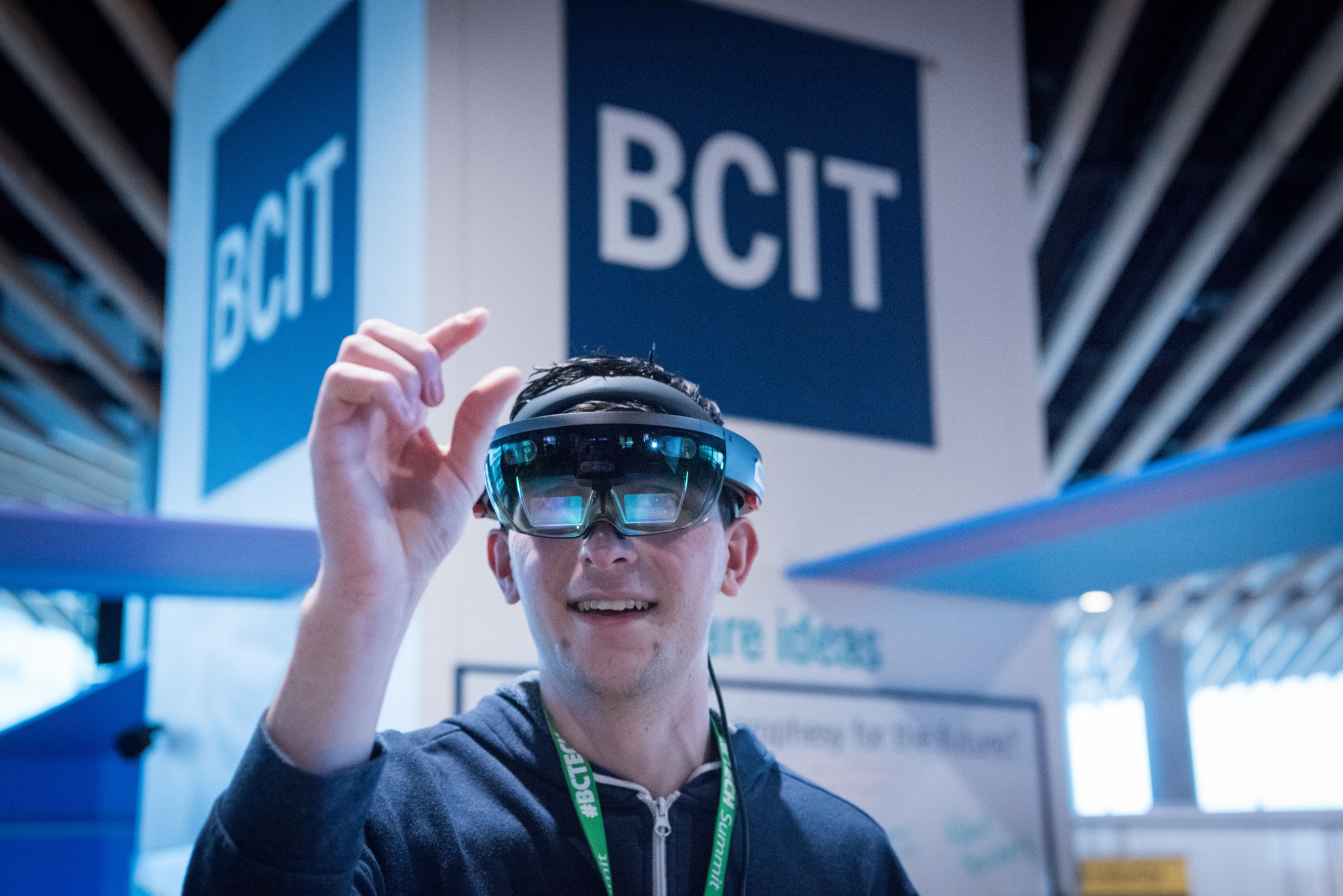 Man wearing Microsoft HoloLens in front of BCIT sign