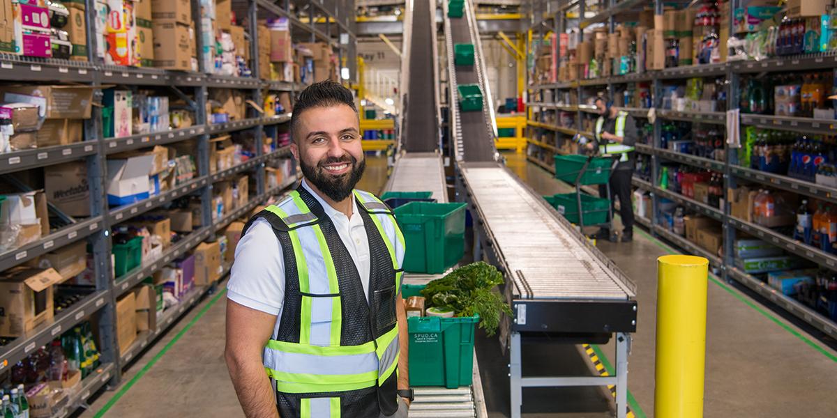Reza in warehouse, smiling