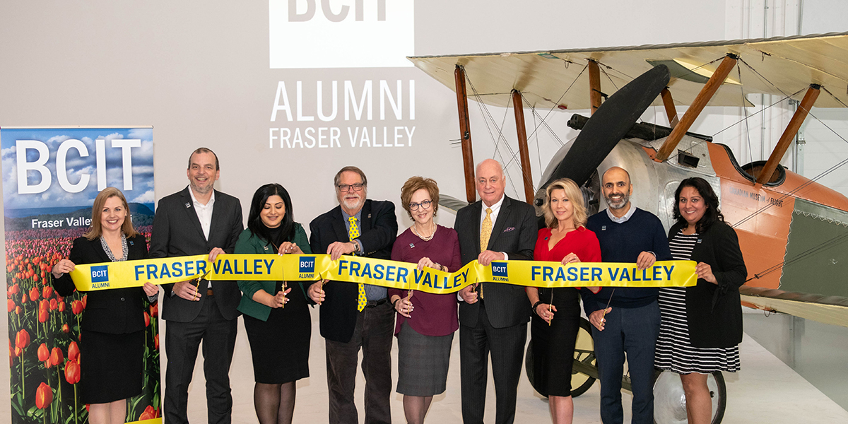 9 representatives from BCIT and businesses from the Fraser Valley cut a yellow ribbon
