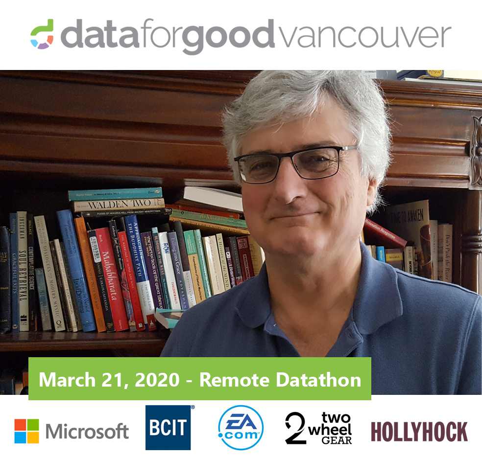 Man in front of bookcase with Data for Good hackathon banner