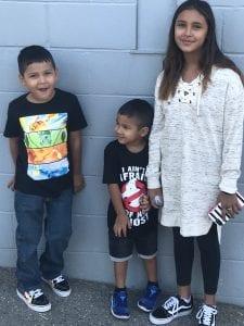 Brandon's three children, smiling at the camera