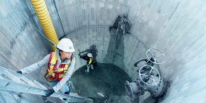 BCIT alumna Amanda Gomes climbs into water tank during BCIT civil engineering studies