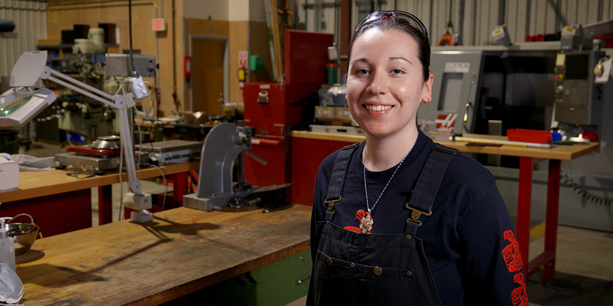 Chelsea Barron in machine shop smiling