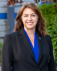 Jennifer Patterson smiles in blazer for alumni-owned businesses article