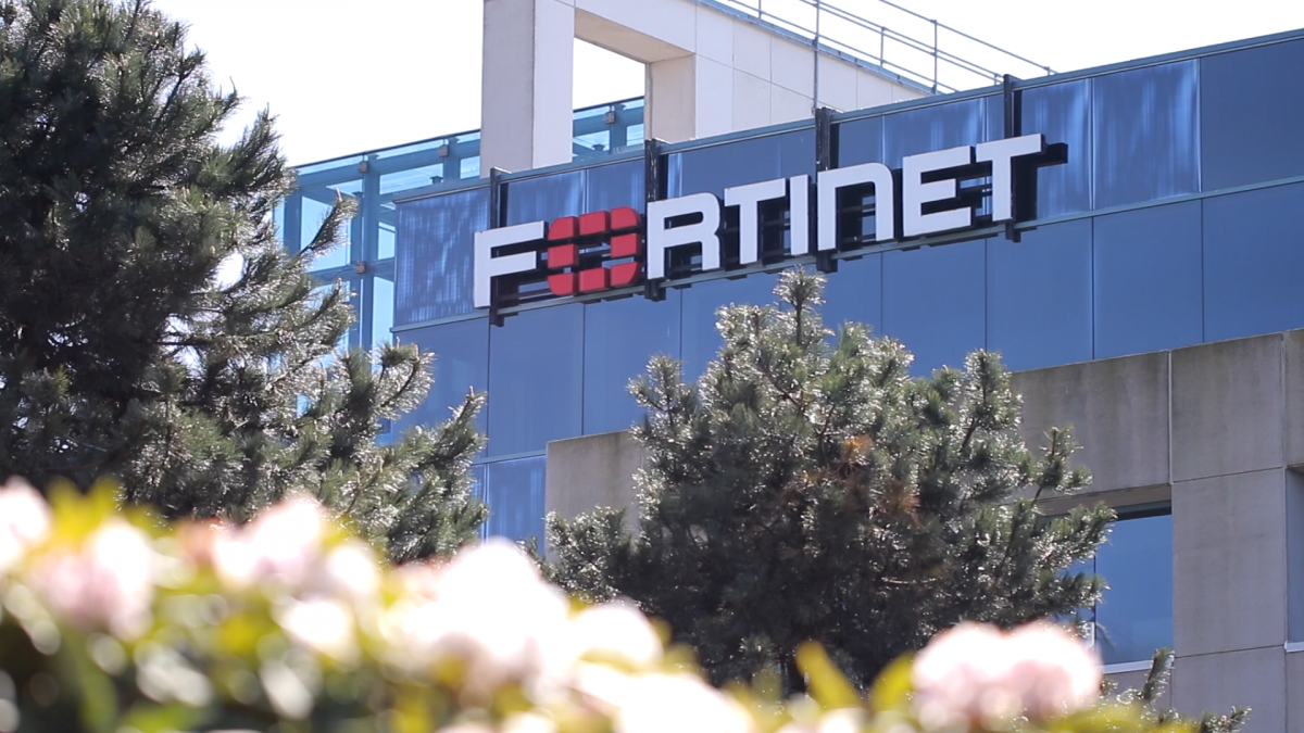 exterior of glass office building with Fortinet sign
